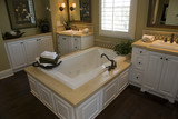 Luxurious bathroom with a modern tub and hardwood floor. poster
