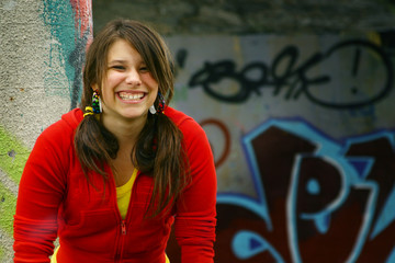 Smiling girl with graffiti in background