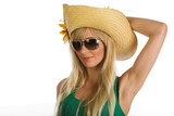 Beautiful blonde girl with summer hat and sunglasses