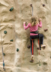Little Girl Scaling Rock Climbing Wall