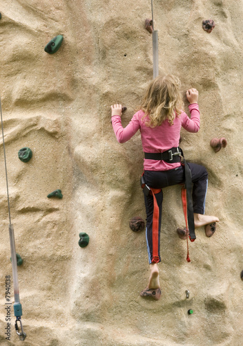 Little Girl Scaling Rock Climbing Wall