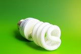 Compact fluorescent light bulb, closeup on green