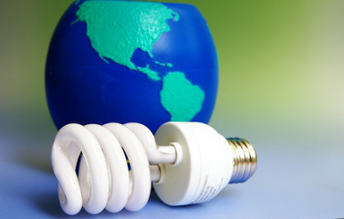 Compact flourescent light bulb with globe background