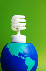 light bulb and an earth globe, on green background