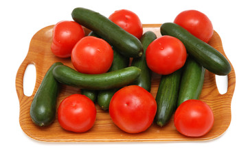 Cucumbers and tomatoes  isolated on the white