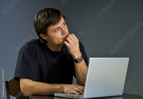 Young person works with the computer