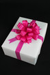 white gift box on black background