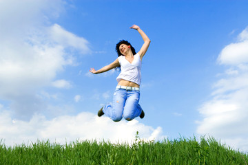 happy young woman is jumping