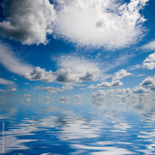 poster of Sea and sky with white fluffy clouds