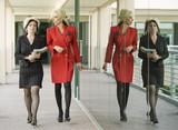 Modern Businesswomen on an Outdoor Walkway poster