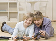 Mother and daughter playing video game