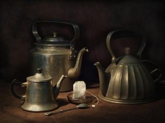 Three teapots with ont tea bag
