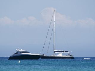 motor yacht and sailboat
