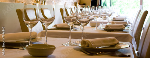 wine glasses set at reataurant table - 7996540