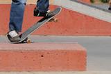 skateboard feet doing tail grind off ramp at skatepark poster