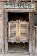 Old Western Swinging Saloon Doors with Sign