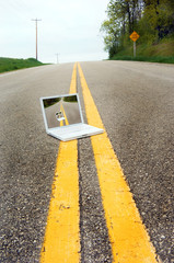 Laptop Computer in the Road