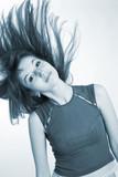 Beautiful girl shaking her hair, monochrome poster