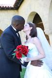 Attractive Interracial Wedding Couple Kissing poster