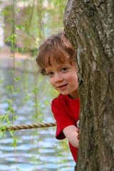 Boy behind a tree