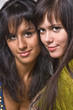 Two beautiful brunettes close up