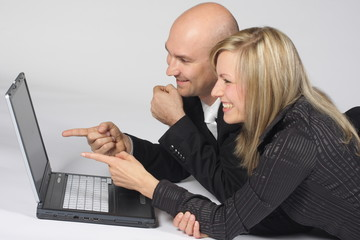 Business Team - Businessman and businesswoman - with Laptop