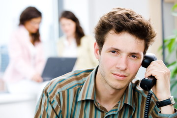 Office worker calling on phone
