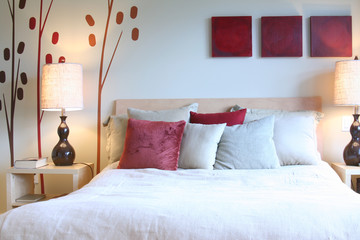 Contemporary bedroom in red and white.