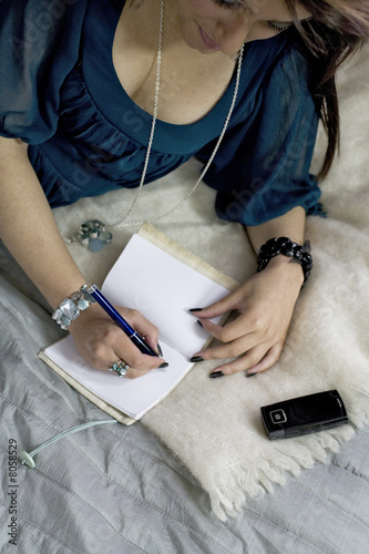 young woman wrighting