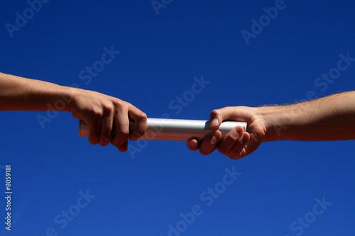Leinwandbild Motiv hands passing the batton