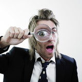 Shocked man and magnifying glass poster