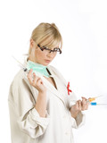 Female blond Nurse with syringes isolated on white background