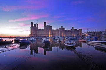 Caernarfon castle and battlements along the River Seiont
