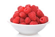Raspberries in a bowl isolated on white background
