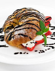 croissant stuffed with cream and fresh stawberry