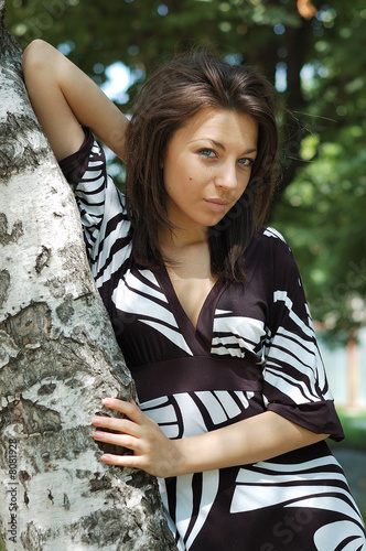 the girl at a birch tree