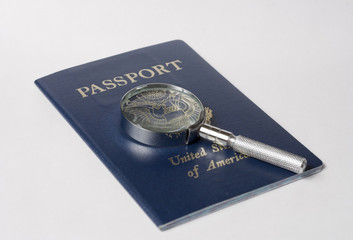Passport under magnifying glass