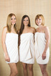three young beautiful women with towels