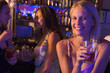 Three young women enjoying drinks at a nightclub