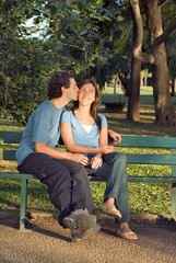 Happy Couple On a Bench - Vertical