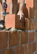 construction worker building a wall