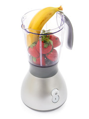 Blender with strawberries and bananas