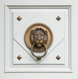 lionhead knocker found on a door of a classical hungarian palace poster