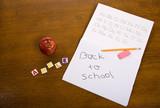 desk, pencil, eraser, book, apple, letters spelling out apple. poster