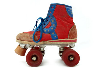 Vintage style old roller skate isolated against white