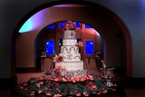 Six tiered wedding cake with pink orchids poster