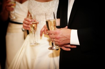 A bride and groom holding champagne glasses