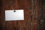 business card fixed on a door with a thumbtack poster