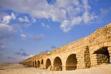 Aqueduct of the Roman period at coast sea poster