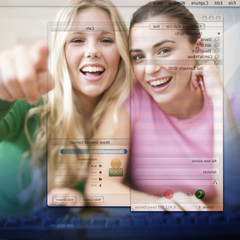 Two teenage girls using a computer